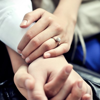 Clasped Hands With Ring